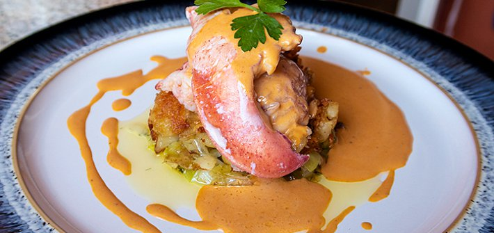 Butter poached lobster with leeks and a lobster sauce