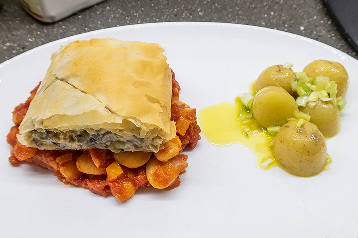 Mushroom strudel with butter beans in tomato sauce