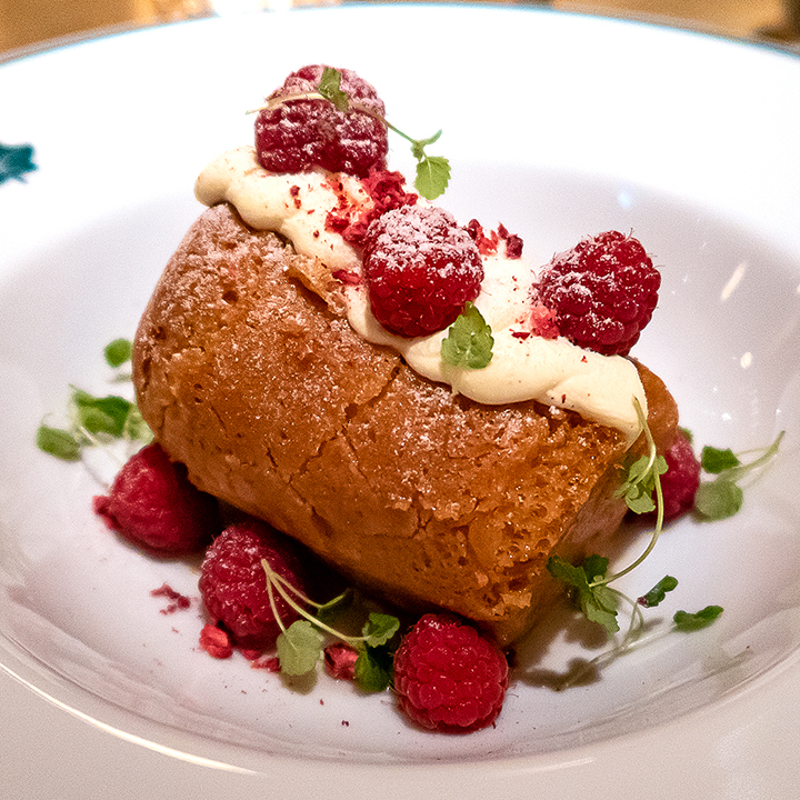 Rum baba with Chantilly cream and raspberries
