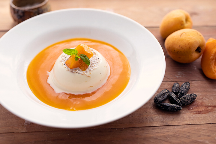Tonka bean panna cotta with apricot coulis